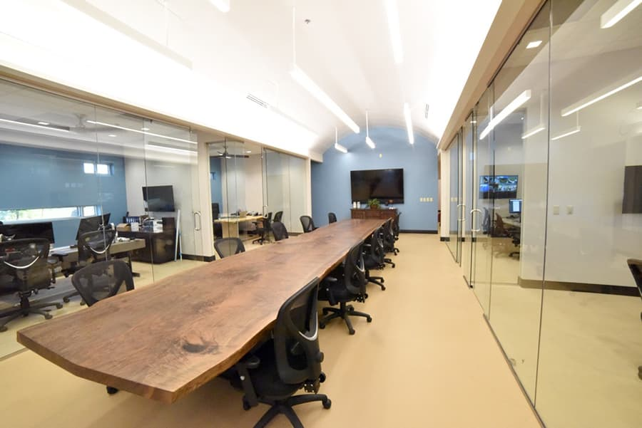 4×22' single walnut slab conference table with steel I-beam base