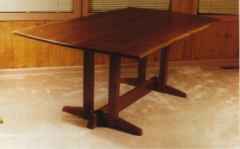 Rustic walnut slab custom dining room table