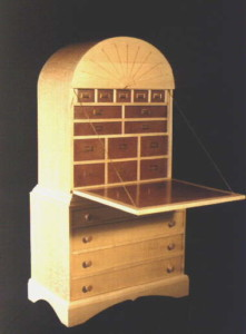 A custom Secretary Desk with quilted maple sides and fiddle back ash front