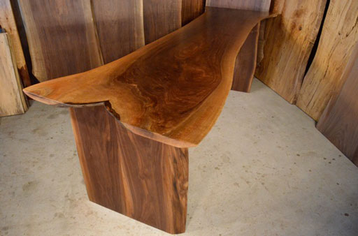 Thick walnut crotch desk with straight natural edge legs