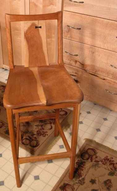 A Carved Cherry Live Edge Bar Stool