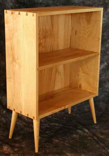 This bookcase has spindle legs