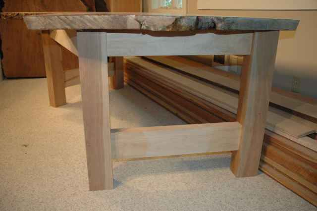 Bookmatched maple crotch table base with thick rectangular cherry legs