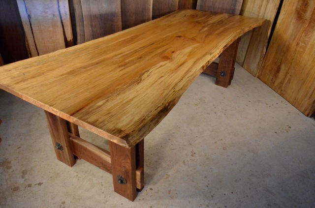 quilted spalted sycamore dining table with walnut timberframe base
