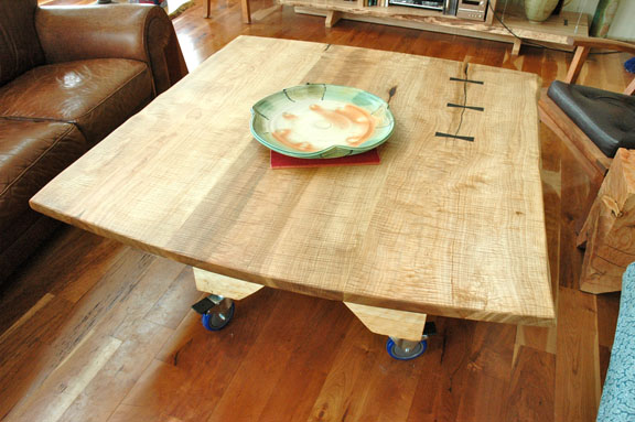 Rustic curly maple wood slab custom dining table with sculpted fir base and inlaid Ebony butterfly accents