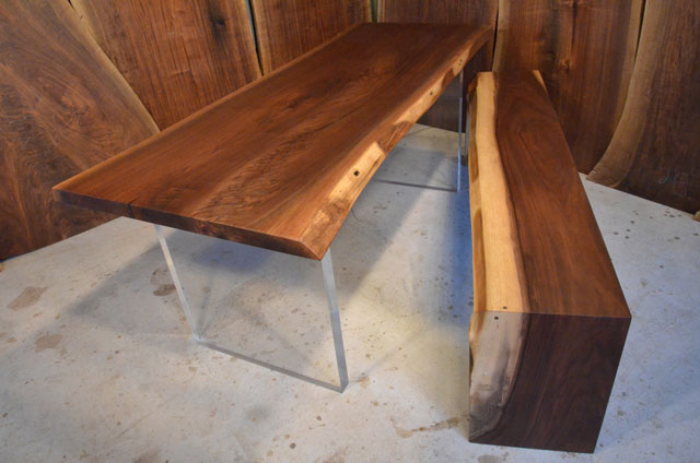 Walnut dining table with custom wooden benches