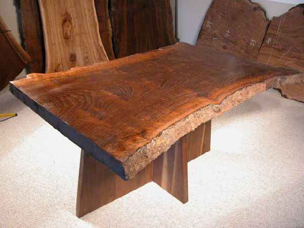 Hourglass shaped claro walnut slab custom dining table for Unique shaped dining tables
