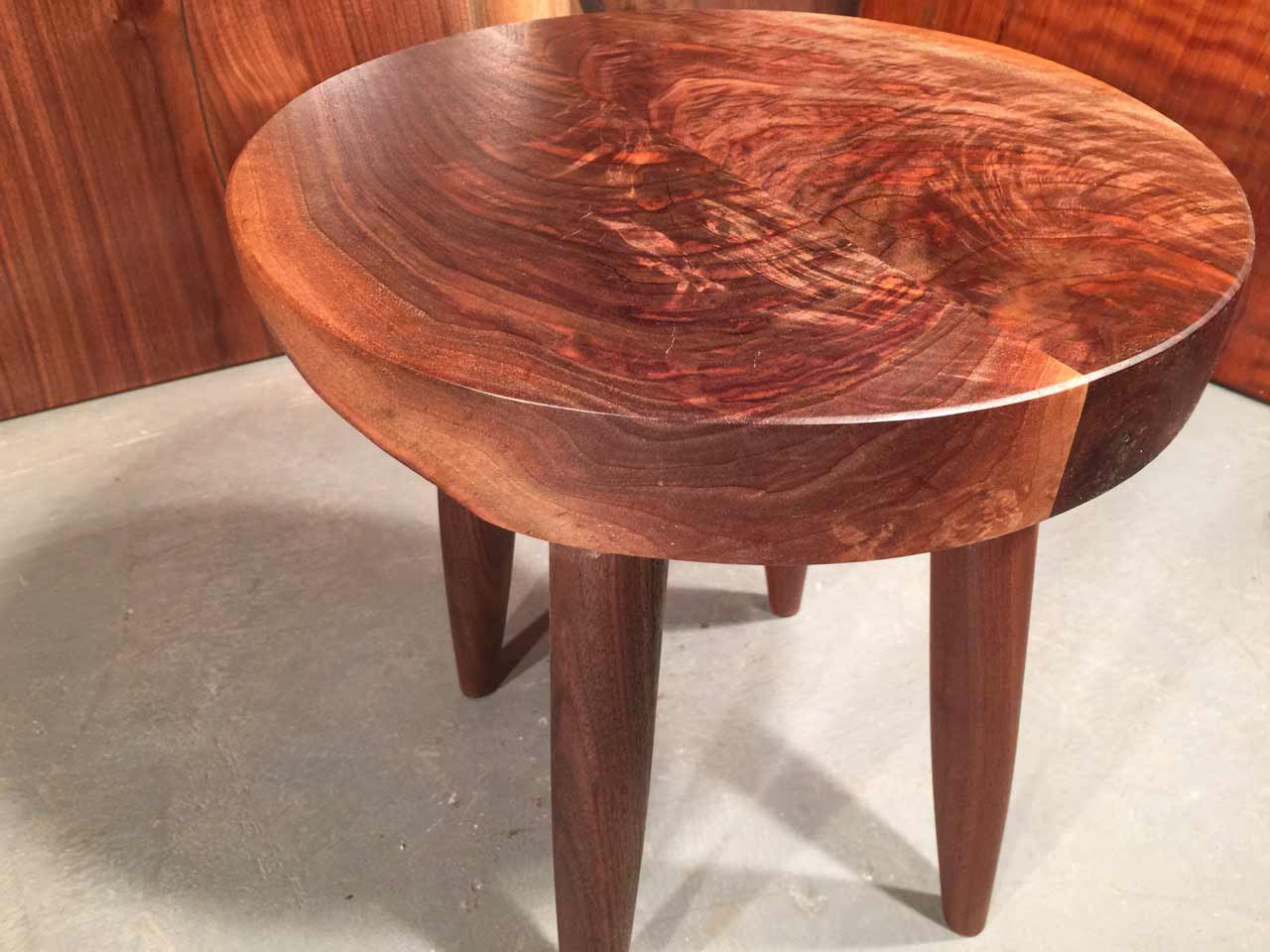 round figured walnut coffee table