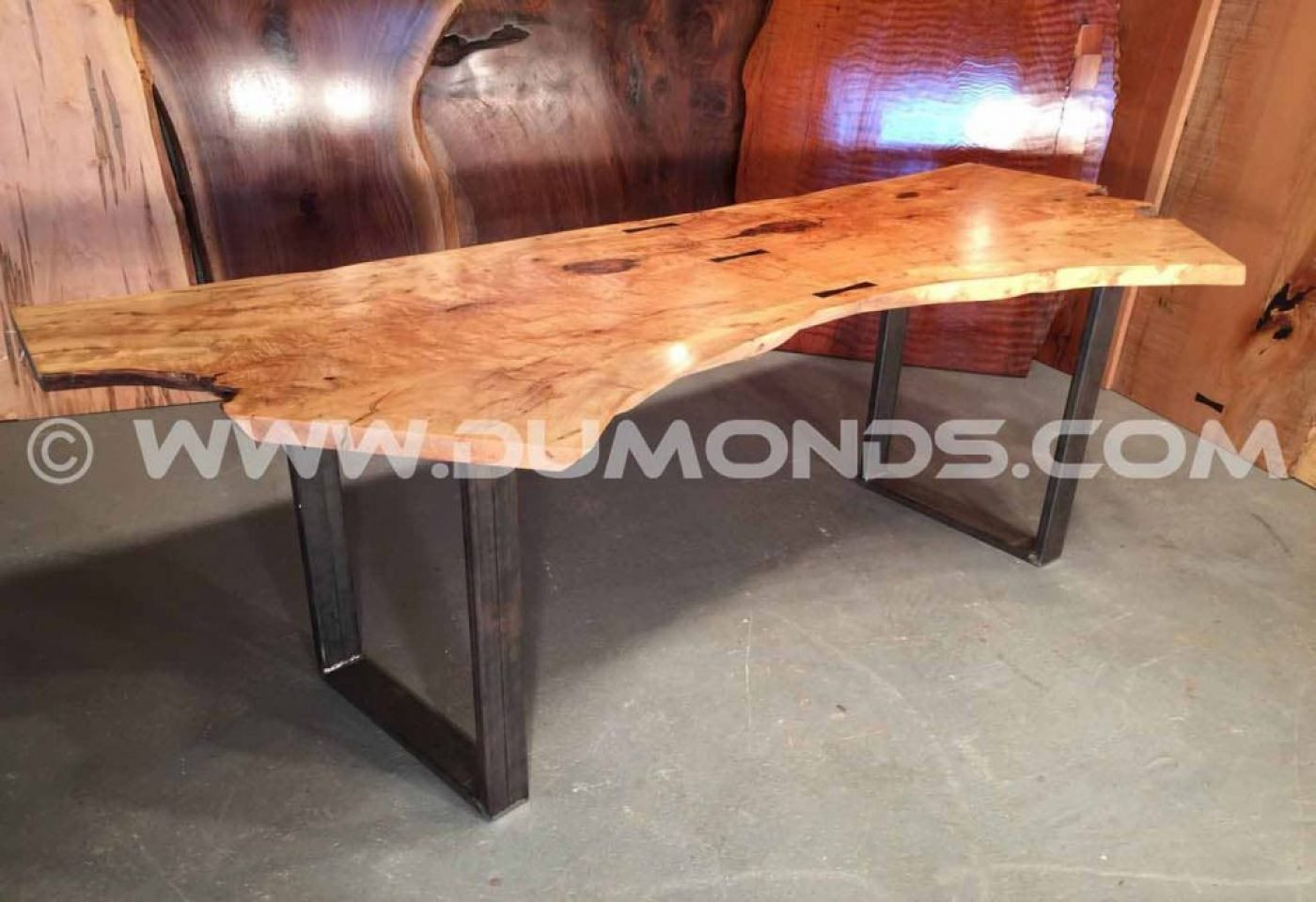 """1×4"""" steel tubing legs shown under a 7' double maple crotch top"""