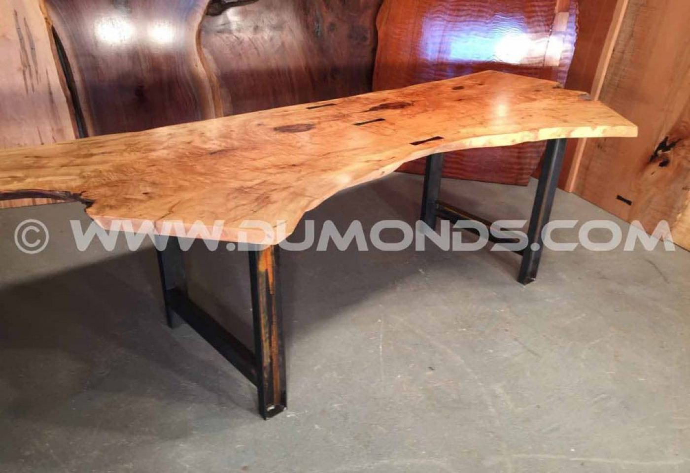 """1.5″x4"""" steel channel legs shown under a 7' double maple crotch top"""