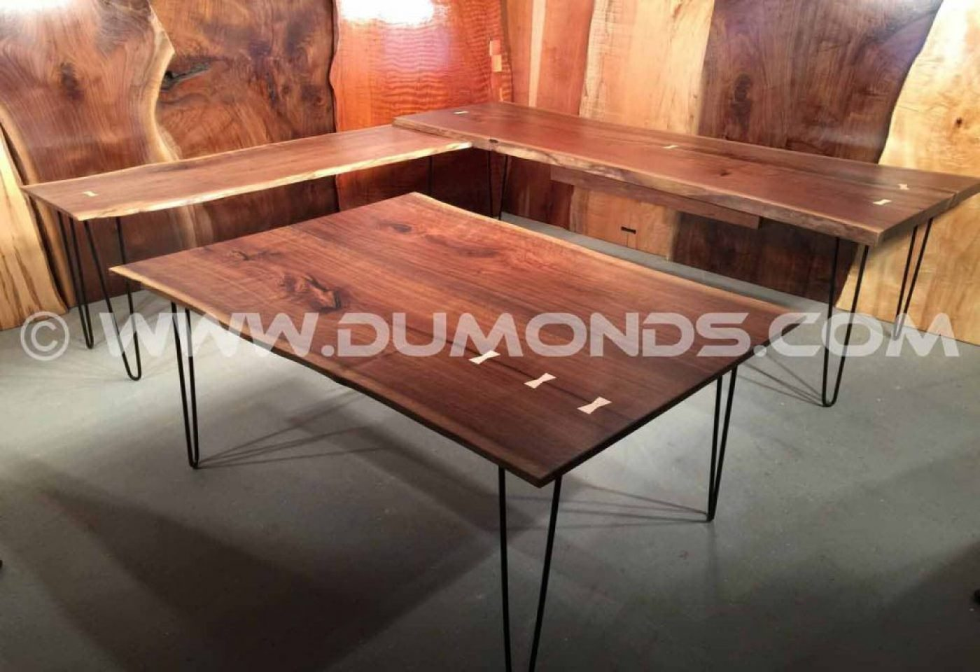 Steel hairpin legs shown under a modular walnut desk