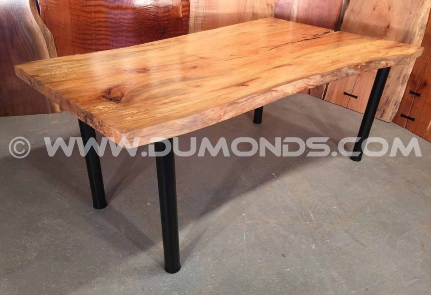 """2"""" black steel legs shown under a 6' urban spalted sycamore top"""