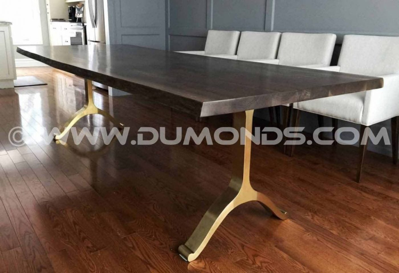 GOLDEN ARCHED STEEL LEGS UNDER A WALNUT LIVE EDGE TABLE TOP