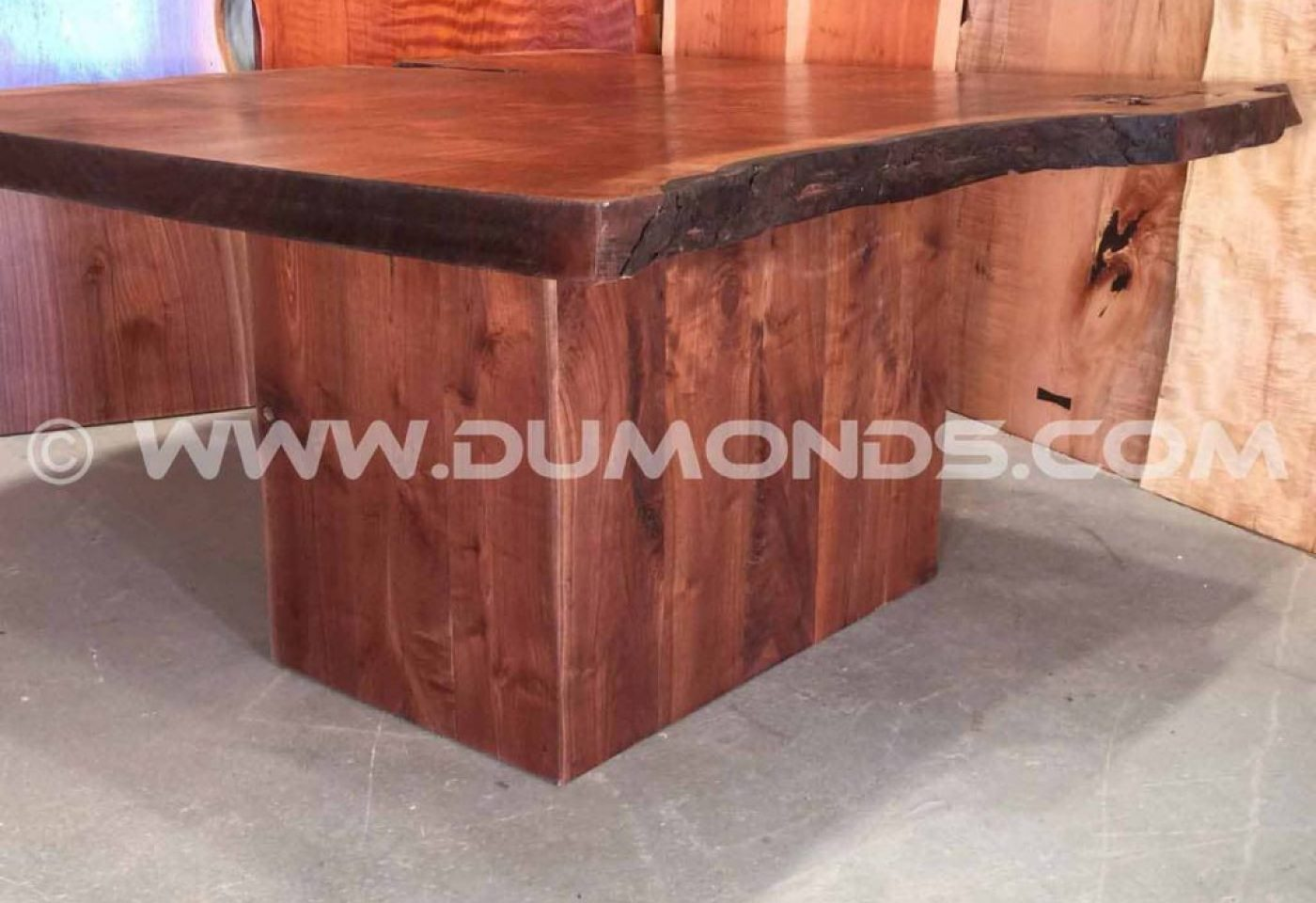 BOXED WALUT TABLE BASE UNDER A CLARO WALNUT LIVE EDGE TABLE TOP