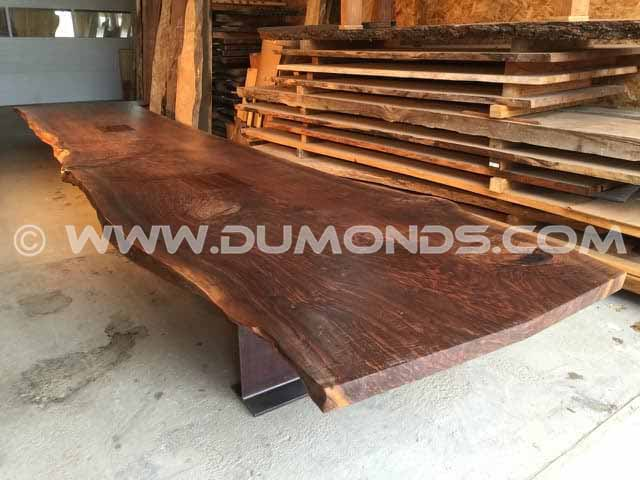single walnut slab conference table with steel I-beam base