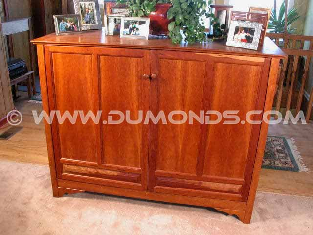 A one piece custom entertainment center in Cherry